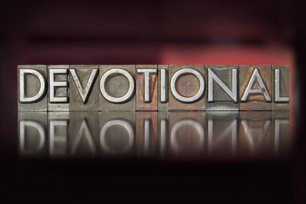 The word Devotional written in vintage letterpress type